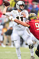 College Park, MD - OCT 1, 2016: Purdue Boilermakers quarterback David Blough (11) drops back into the pocket pursuded by Maryland Terrapins defensive lineman Roman Braglio (90) during game between Maryland and Purdue at Capital One Field at Maryland Stadium in College Park, MD. The Terps got the win 50-7 over visiting Purdue. (Photo by Phil Peters/Media Images International)