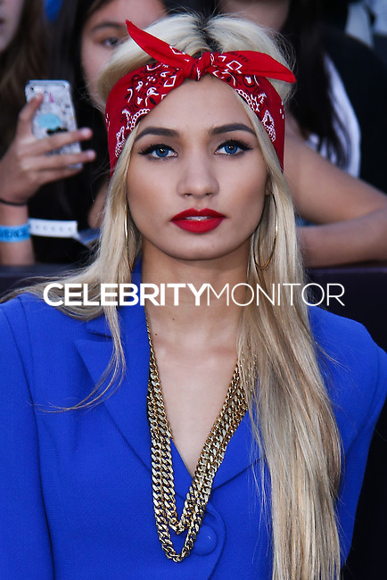 "WESTWOOD, LOS ANGELES, CA, USA - MARCH 18: Pia Mia Perez at the World Premiere Of Summit Entertainment's ""Divergent"" held at the Regency Bruin Theatre on March 18, 2014 in Westwood, Los Angeles, California, United States. (Photo by David Acosta/Celebrity Monitor)"