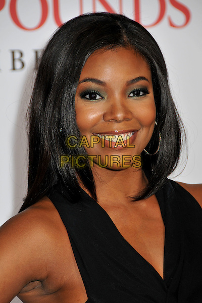 "GABRIELLE UNION.""Seven Pounds"" Los Angeles Premiere at Mann's Village Theatre, Westwood, California, USA..December 16th, 2008.headshot portrait black green eyeshadow .CAP/ADM/BP.©Byron Purvis/AdMedia/Capital Pictures."