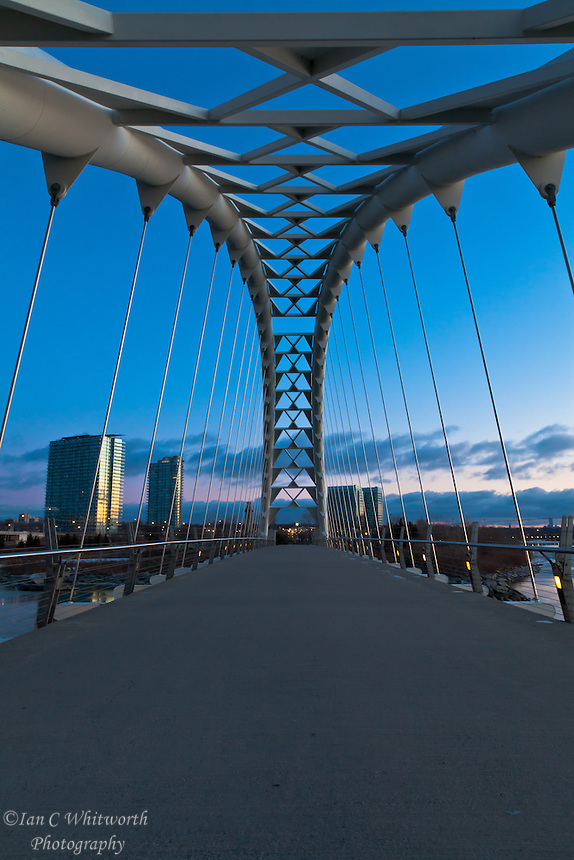 Looking across the Humber Bay Arch Bridge in Toronto at dawn.