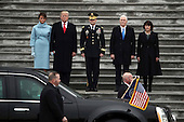The presidential limousine pulls up after United States. President Donald Trump (2L), with (L-R) first lady Melania Trump, Maj. Gen. Bradley Becker, Vice President Mike Pence and his wife Karen Pence reviewed troops on the East Front of the U.S. Capitol on January 20, 2017 in Washington, DC. In today's inauguration ceremony Donald J. Trump becomes the 45th president of the United States. <br /> Credit: Michael Heiman / Pool via CNP
