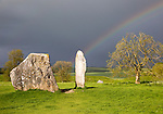 Rainbow over standing stones at Avebury, Wiltshire, England, UK