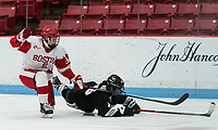 BOSTON, MA - JANUARY 11: Abby Cook #9 of Boston University takes down Ciara Barone #16 of Providence College during a game between Providence College and Boston University at Walter Brown Arena on January 11, 2020 in Boston, Massachusetts.