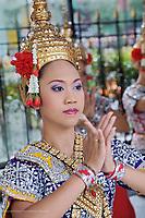 Dancer in traditional Thai costume, Erawan Shrine, Bangkok, Thailand.
