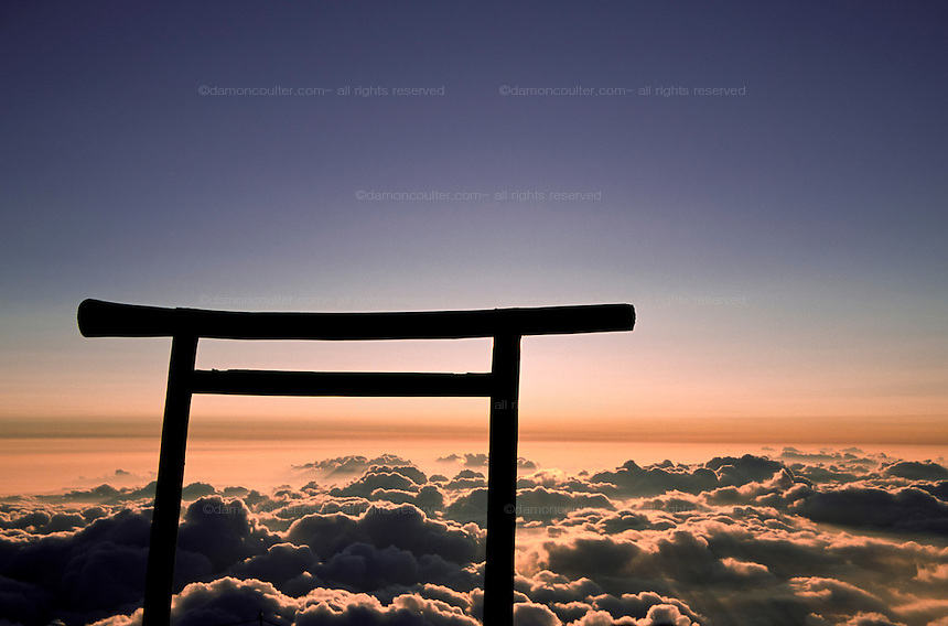 A torii gate above clouds near the summit of Mount Fuji, at 3,776 metres, the highest peak in Japan. Yamanashi prefecture, Japan. October 3rd 2004