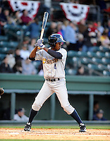 Infielder Claudio Custodio (4) of the Charleston RiverDogs in a game against the Greenville Drive on Opening Day, Friday, April 5, 2013, at Fluor Field at the West End in Greenville, South Carolina. (Tom Priddy/Four Seam Images)