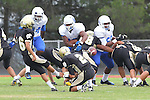Palos Verdes, CA 09/16/11 - Charles Chae (Peninsula #16), Ian Escutia (Peninsula #2), \Malik Deckard (Culver City #24), Devan Carton (Culver City #58) and unidentified Culver City. player(s) in action during the Culver City-Peninsula varsity football game.
