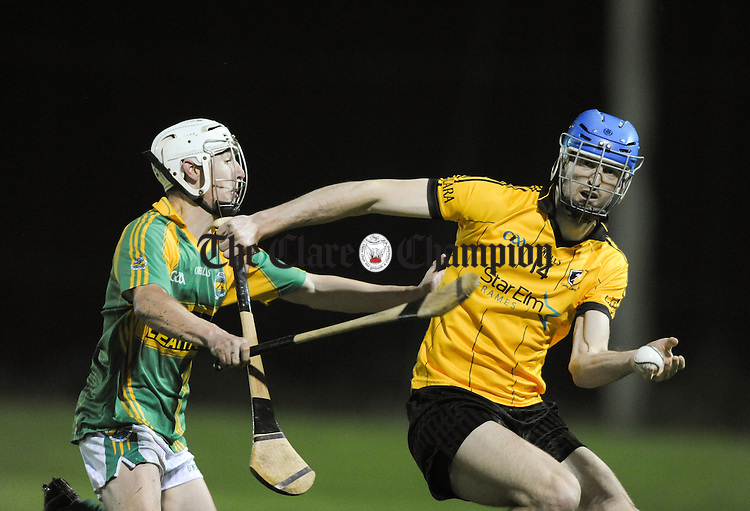 Aidan O Brien of Broadford in action against Darach Honan of Clonlara during their Clare Champion Cup game at Gurteen. Photograph by John Kelly.