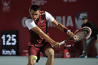 BOGOTA- COLOMBIA 24-07-2015: Bernard Tomic de Australia, devuelve la bola a Tatsuma Ito de Japon durante partido del ATP Claro Open Colombia de Tenis en las canchas del Centro de Alto rendimiento en Altura en la ciudad de Bogota. / Bernard Tomic of Australia returns the ball to Tatsuma Ito of Japan during a match to the ATP Claro Open Colombia of Tennis in the courts of the High Performance Center in Altura in Bogota City. Photo: VizzorImage / Luis Ramirez / Staff.