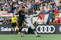 FOXBOROUGH, MA - AUGUST 4: Mark-Anthony Kaye #14 of Los Angeles FC attempts to control the ball as Cristian Penilla #70 of New England Revolution pressures during a game between Los Angeles FC and New England Revolution at Gillette Stadium on August 3, 2019 in Foxborough, Massachusetts.
