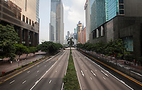 Normally busy Gloucester Road, a main thoroughfare through Hong Kong's busy Wan Chai district appears strangely quiet on day three of the mass civil disobedience campaign Occupy Central, Hong Kong, China, 30 September 2014.