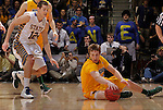 SIOUX FALLS, SD - MARCH 12:  Mike Felt #3 of North Dakota State picks up a loose ball as Brayden Carlson #12 of South Dakota State closes in during their championship game at the 2013 Summit League Tournament at the Sioux Falls Arena. (Photo by Dick Carlson/Inertia)
