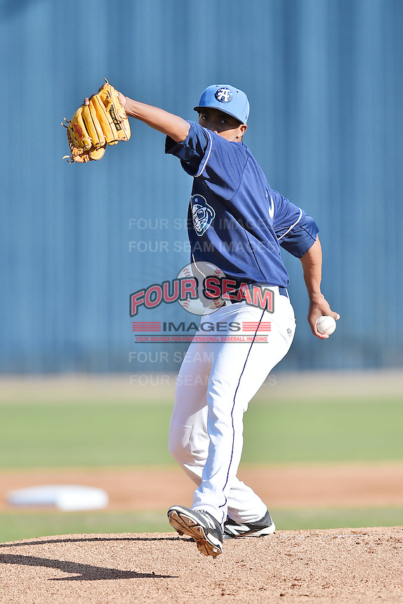 Asheville Tourists starting pitcher Johendi Jiminian #31 delivers a pitch during a game against the Lakewood BlueClaws at McCormick Field on May 3, 2014 in Asheville, North Carolina. The BlueClaws defeated the Tourists 7-4. (Tony Farlow/Four Seam Images)