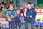 TOYS: Dylan,Tom and Darragh Moriarty and Sean Lucid (Ballyduff) playing with their toy tractors at the Abbeydorney Ploughing competition on Sunday in Abbeydorney........... . ............................... ..........