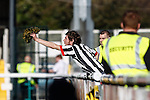 A Grimsby Town fan offers up his wig to players during the Vanamara Conference League match between Woking and Grimsby Town at the Kingfield Stadium, Woking, Surrey<br /> Picture by David Horn/eXtreme aperture photography +44 7545 970036<br /> 07/03/2015