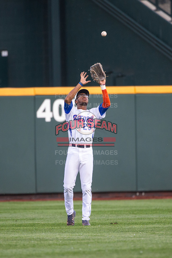 Buddy Reed (23) of the Florida Gators fields during a game between the Miami Hurricanes and Florida Gators at TD Ameritrade Park on June 13, 2015 in Omaha, Nebraska. (Brace Hemmelgarn/Four Seam Images)