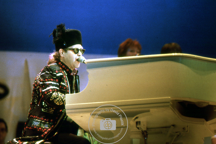 ELTON JOHN - performing live at Live Aid at Wembley Stadium, London, England - July 13, 1985 Elton John