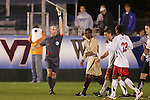 14 November 2008: Referee Brent Sorg (left) shows a yellow card to Boston College's Edvin Worley (second from left). The University of Maryland defeated Boston College 1-0 at WakeMed Stadium at WakeMed Soccer Park in Cary, NC in a men's ACC tournament semifinal game.