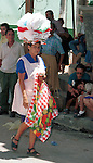 Woman with clean clothes on head San Salvador El Salvador Central America, Fine Art Photography by Ron Bennett, Fine Art, Fine Art photography, Art Photography, Copyright RonBennettPhotography.com ©