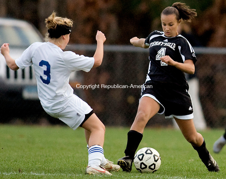 BURLINGTON, CT - 02 NOVEMBER 2009 -110209JT19-<br /> Terryville's Jess Albino handles the ball while under pressure from Lewis Mills' Carly Marenna during Monday's game at Nassahegan field in Burlington. The game was tied, 0-0.<br /> Josalee Thrift Republican-American