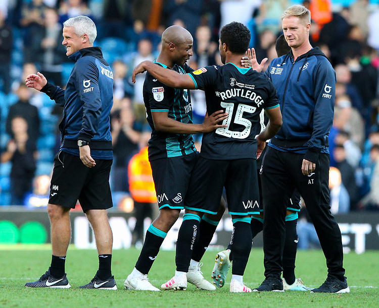 Swansea City's Wayne Routledge celebrates with Andre Ayew after the game<br /> <br /> Photographer Alex Dodd/CameraSport<br /> <br /> The EFL Sky Bet Championship - Leeds United v Swansea City - Saturday 31st August 2019 - Elland Road - Leeds<br /> <br /> World Copyright © 2019 CameraSport. All rights reserved. 43 Linden Ave. Countesthorpe. Leicester. England. LE8 5PG - Tel: +44 (0) 116 277 4147 - admin@camerasport.com - www.camerasport.com
