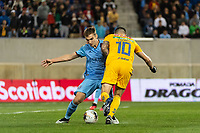 HARRISON, NJ - MARCH 11: James Sands #16 of NYCFC and Andre Gignac #10 of Tigres UANL collide during a game between Tigres UANL and NYCFC at Red Bull Arena on March 11, 2020 in Harrison, New Jersey.