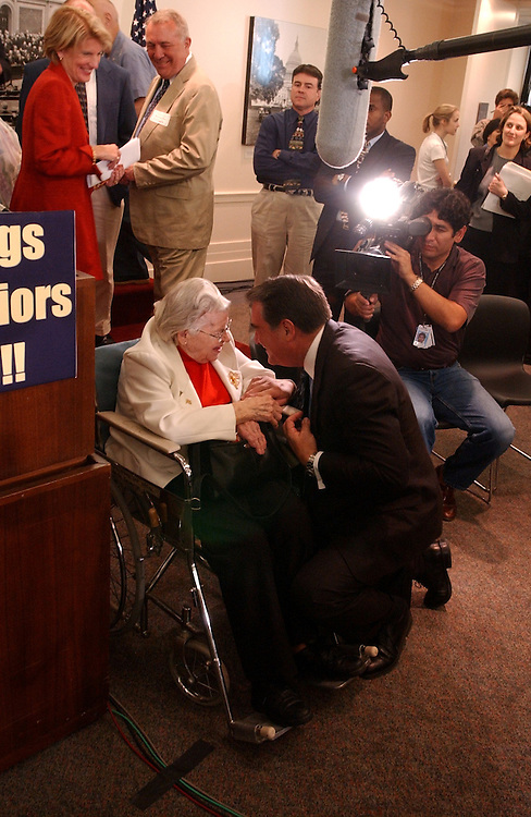 drugs3/062603 - Rep. Billy Tauzin, R-La., talks with Mattie Wimer, 83,  of Martinburg, W.V., and during rally for prescription drugs, Thursday.