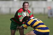 P Baird attemps to push off B. Batten.  Counties Manukau Premier Club Rugby, Waiuku vs Patumahoe played at Rugby Park, Waiuku on the 8th of April 2006. Waiuku won 18 - 15