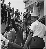 """Actor Sammy Davis, Jr. waves to the crowd from the Lincoln Memorial at the 1963 March on Washington for Jobs and Freedom in Washington, D.C.  on August 28, 1963.  At this march, Dr. Martin Luther King, Jr. delivered his """"I Have a Dream"""" speech.<br /> Credit: National Archives via CNP"""