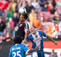 Dwayne De Rosario (7) of D.C. United goes up for a header with Conor Casey (6) of the Philadelphia Union during the game at the RFK Stadium in Washington DC.  Philadelphia defeated D.C. United, 3-2.