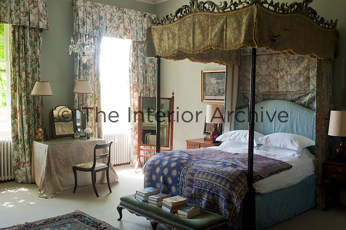 The carved four-poster bed in this bedroom is original to the house and the room is decorated with naval engravings which remind visitors of Pylewell's seaside location