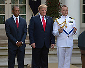 "United States President Donald J. Trump, center, presents the Presidential Medal of Freedom to professional golfer Tiger Woods, left, in the Rose Garden of the White House in Washington, DC on May 6, 2019.  The Presidential Medal of Freedom is an award bestowed by the President of the United States to recognize those people who have made ""an especially meritorious contribution to the security or national interests of the United States, world peace, cultural or other significant public or private endeavor.""<br /> Credit: Ron Sachs / CNP"