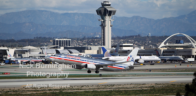 LOS ANGELES, CALIFORNIA, USA - JANUARY 28, 2013 - American Airlines Boeing 737-823 takes off from Los Angeles Airport on January 28, 2013. The plane seats 126 passengers with a range of 10,200 km