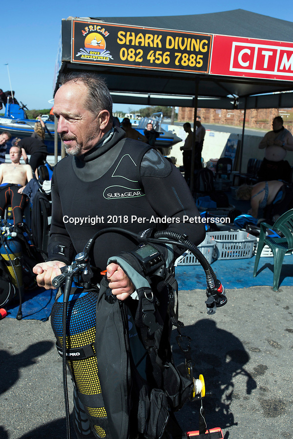 MARGATE, SOUTH AFRICA APRIL 25: Shark expert and biologist Erich Ritter prepares to go on a shark dive trip, with an African Adventure diving boat, during an early morning dive at Protea Banks on April 25, 2018 in KwaZulu Natal, South Africa. The area is one of the best in South Africa for shark encounters. (Photo by: Per-Anders Pettersson/Getty Images)