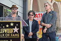 LOS ANGELES, CA. September 2, 2016: Dave Stewart (left) with Daryl Hall &amp; John Oates at the Hollywood Walk of Fame star ceremony honoring musicians Daryl Hall &amp; John Oates. <br /> Picture: Paul Smith / Featureflash