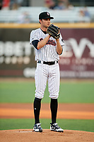 Birmingham Barons starting pitcher Spencer Adams (12) looks in for the sign during a game against the Pensacola Blue Wahoos on May 8, 2018 at Regions FIeld in Birmingham, Alabama.  Birmingham defeated Pensacola 5-2.  (Mike Janes/Four Seam Images)