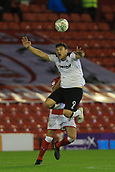 12th September 2017, Oakwell, Barnsley, England; Carabao Cup, second round, Barnsley versus Derby County; Chris Martin of Derby County gets up high to beat Adam Jackson of Barnsley FC to the ball