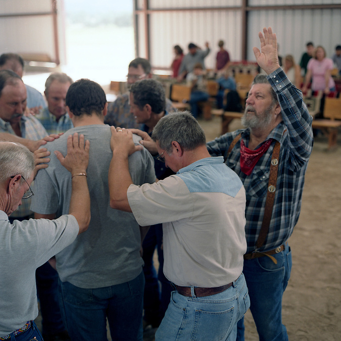 Cowboy Church. Texas, USA. 2007. Although the Cowboy Church seems a very alternative method of worship it has it's roots in Evangelical Christianity. They have some of the same rituals including anointing in oils and laying on of hands.