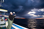 A fisherman prepares the line for blue fin tuna fishing on the Gulf of St. Lawrence near North Rustico, PEI, Canada.