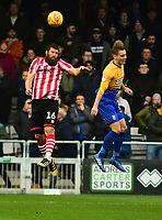 Lincoln City's Michael Bostwick clears under pressure from  Mansfield Town's Danny Rose<br /> <br /> Photographer Andrew Vaughan/CameraSport<br /> <br /> The EFL Sky Bet League Two - Lincoln City v Mansfield Town - Saturday 24th November 2018 - Sincil Bank - Lincoln<br /> <br /> World Copyright &copy; 2018 CameraSport. All rights reserved. 43 Linden Ave. Countesthorpe. Leicester. England. LE8 5PG - Tel: +44 (0) 116 277 4147 - admin@camerasport.com - www.camerasport.com