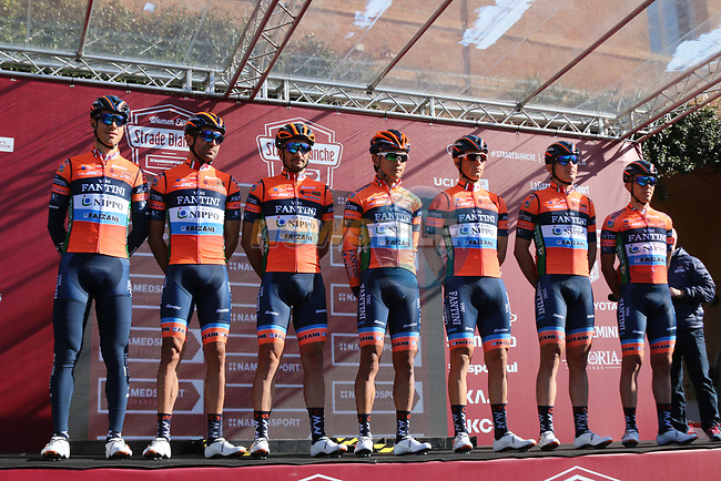 Nippo-Vini Fantini-EUR.OV. at sign on before the start of Strade Bianche 2019 running 184km from Siena to Siena, held over the white gravel roads of Tuscany, Italy. 9th March 2019.<br /> Picture: Seamus Yore | Cyclefile<br /> <br /> <br /> All photos usage must carry mandatory copyright credit (© Cyclefile | Seamus Yore)