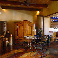 The intimate dining room is full of African artefacts and sculptures
