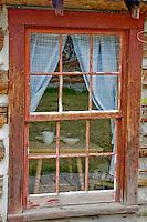 Old window of historic house. Nevada City, Montana