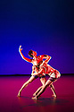 London, UK. 03.12.2013. STRANGE BLOOMS, Shobana Jeyasingh's new work, commissioned by the Southbank Centre, has its world premiere at the Queen Elizabeth Hall. Dancers are: Avatara Ayuso, Richard Causer, Sunbee Han, Noora Kela, Simone Muller-Lotz, Teerachai Thobumrung, Lee-Yuan Tu, Hian Ruth Voon. Picture shows: Noora Kela and Lee-Yuan Han. Photograph © Jane Hobson.