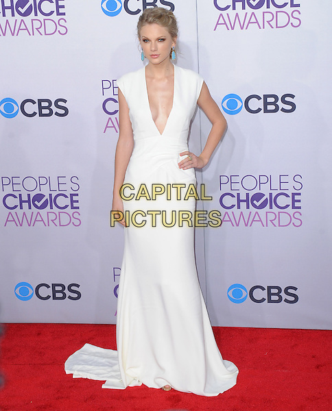 Taylor Swift.The 2013 People's Choice Awards held at Nokia Live in Los Angeles, California 9th January 2013                                                                   .full length white dress plunging neckline hand on hip cleavage .CAP/DVS.©DVS/Capital Pictures.