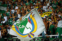 CALI -COLOMBIA-28-AGOSTO-2014. Seguidores del Deportivo Cali de Colombia muestran el apoyo a su equipo durante el partido contra de UTC Cajamarca del Peru durante las eliminatorias de la Copa Sudamericana jugado en el estadio Pascual Guerrero de la ciudad de  Cali . / Followers of Deportivo Cali of Colombia show support to their team during tha match against UTC Cajamarca Peru for qualifying of the Copa Sudamericana played in Pascual Guerrero stadium in Cali.  Photo: VizzorImage / Juan Carlos Quintero / Stringer