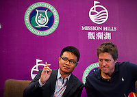 HAIKOU, CHINA - OCTOBER 28:  Dr. Ken Chu (L), Vice Chairman of Mission Hills Group and Hollywood start Hugh Grant of Great Britain laugh during a press conference as part of the Mission Hills Star Trophy on October 28, 2010 in Haikou, China. The Mission Hills Star Trophy is Asia's leading leisure liflestyle event and features Hollywood celebrities and international golf stars.  Photo by Victor Fraile / studioEAST