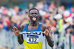 LOUISVILLE, KY - NOVEMBER 18: Peter Lomong #432 of Northern Arizona University pops out his uniforms en route to the finish line during the Division I Men's Cross Country Championship held at E.P. Tom Sawyer Park on November 18, 2017 in Louisville, Kentucky. (Photo by Tim Nwachukwu/NCAA Photos via Getty Images)