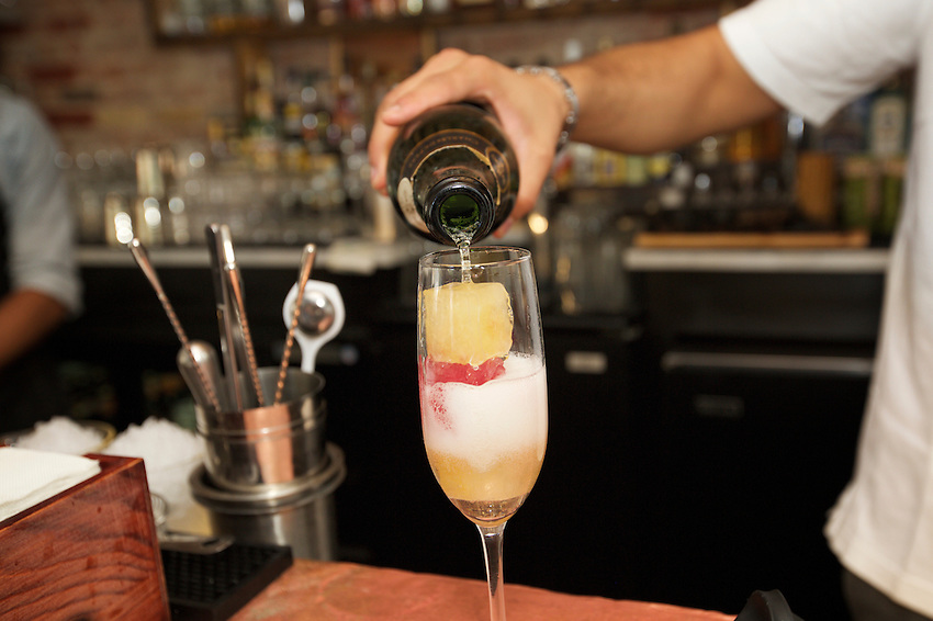 Jersey City, NJ - April 27, 2016: The bottomless Mimosa, champagne filled with cubes of frozen orange and cranberry juice, at The Kitchen Step, the new modern American restaurant by chef Ryan DePersio in Jersey City.<br /> <br /> CREDIT: Clay Williams for Gothamist<br /> <br /> &copy; Clay Williams / claywilliamsphoto.com