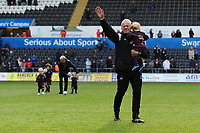 Alan Curtis, assistant coach for Swansea City applauds the fans at the final whistle during the Sky Bet Championship match between Swansea City and Hull City at the Liberty Stadium in Swansea, Wales, UK. Saturday 27 April 2019